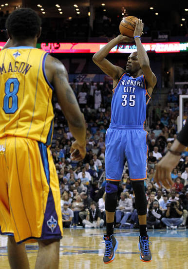 Oklahoma City's Kevin Durant (35) shoots the ball in front of New Orleans Hornets Roger Mason Jr. (8) during the second half of an NBA basketball game in New Orleans, Friday, Nov. 16, 2012. The Thunder won 110-95. (AP Photo/Jonathan Bachman) ORG XMIT: LAJB108