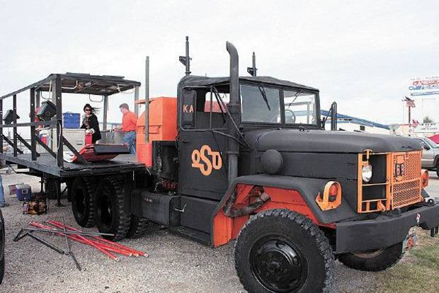 Agent Orange, a military-issue Deuce and a half, is the centerpiece of one of the Oklahoma State tailgating teams that made the semifinals of the Bedlam Tailgating Showdown <strong>DAVE CATHEY - THE OKLAHOMAN</strong>