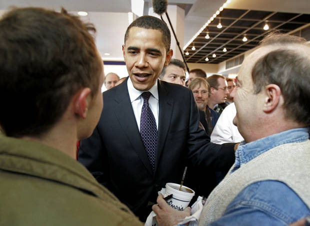 FILE - In this Jan. 3, 2008 file photo, then-Democratic presidential hopeful, Sen. Barack Obama, D-Ill., greets diners at a food court on caucus day, in Des Moines, Iowa. For President Barack Obama, it�s ending where it all began. Obama will close his 2012 campaign with a nighttime rally in Iowa, where his 2008 caucus victory jumpstarted his road to the White House. The president is expected to reflect back on the state�s pivotal role in his political rise during remarks delivered at the site of his first Iowa campaign headquarters. (AP Photo/M. Spencer Green, File)