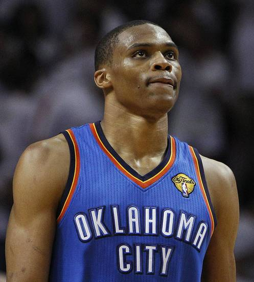Oklahoma City Thunder point guard Russell Westbrook leaves the floor after Game 3 of the NBA Finals basketball series against the Miami Heat, Sunday, June 17, 2012, in Miami. Miami won 91-85. (AP Photo/Lynne Sladky) ORG XMIT: NBA156