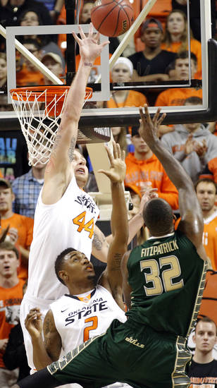 Oklahoma State 's Philip Jurick (44) and Le'Bryan Nash (2) defend a shot by South Florida Bulls' Toarlyn Fitzpatrick (32) during the college basketball game between Oklahoma State University (OSU) and the University of South Florida (USF) on Wednesday , Dec. 5, 2012, in Stillwater, Okla.   Photo by Chris Landsberger, The Oklahoman
