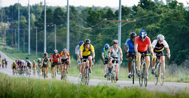 Riders travel south on NE 120th street in the 2008 Norman Conquest Bike Ride benefitting the J.D. McCarty Center in Norman, Oklahoma Saturday, July 19, 2008.    BY STEVE SISNEY, THE OKLAHOMAN