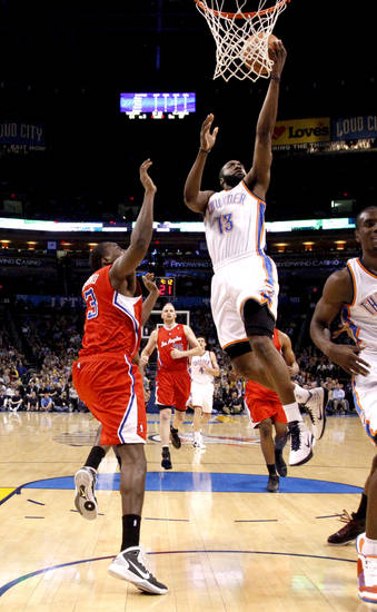Oklahoma City's James Harden (13) goes past Los Angeles' Al-Farouq Aminu (3) during the NBA basketball game between the Oklahoma City Thunder and the Los Angeles Clippers at the Oklahoma CIty Arena, Tuesday, Feb. 22, 2011.  Photo by Bryan Terry, The Oklahoman