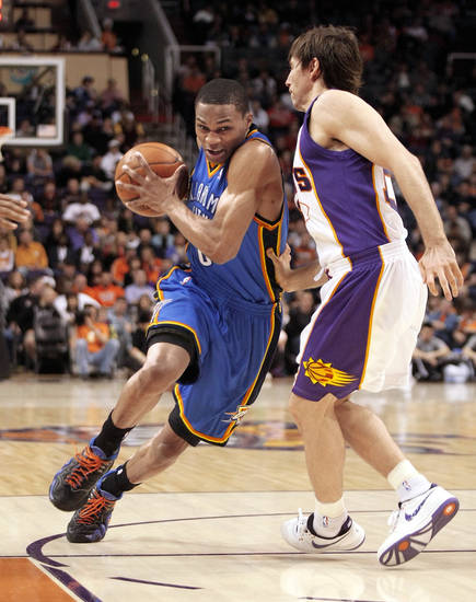 Oklahoma City's Russell Westbrook, left, drives past the Suns' Steve Nash during action Wednesday in Phoenix. AP photo