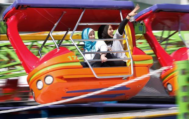 Elaf Alshak, left and Fatemah Alaslman ride the Enterprise at the Oklahoma State Fair in Oklahoma City, September 20 , 2010. Photo by Steve Gooch, The Oklahoman ORG XMIT: KOD