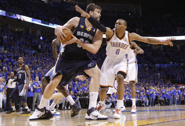 Oklahoma City's Russell Westbrook (0) defends on Marc Gasol (33) of Memphis during game two of the Western Conference semifinals between the Memphis Grizzlies and the Oklahoma City Thunder in the NBA basketball playoffs at Oklahoma City Arena in Oklahoma City, Tuesday, May 3, 2011. Photo by Chris Landsberger, The Oklahoman