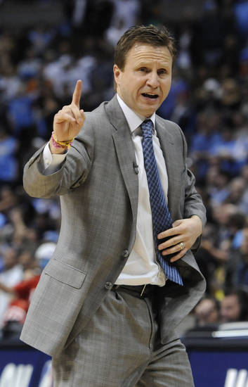 Oklahoma City Thunder head coach Scott Brooks looks on during the second half of game 3 of a first-round NBA basketball playoff series against the Denver Nuggets Saturday, April 23, 2011, in Denver. Oklahoma City beat Denver 97-94 to take a 3-0 series lead. (AP Photo/Jack Dempsey)
