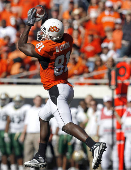 OSU&#039;s Justin Blackmon makes a catch during the college football game between the Oklahoma State University Cowboys (OSU) and the Baylor University Bears at Boone Pickens Stadium in Stillwater, Okla., Saturday, Nov. 6, 2010. Photo by Sarah Phipps, The Oklahoman