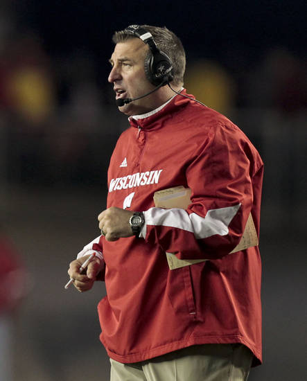   Wisconsin coach Bret Bielema directs his team from the sidelines during the second half of a college football game against Ohio State Saturday, Nov. 17, 2012, in Madison, Wis. Ohio State won 21-14 in overtime. (AP Photo/Andy Manis)  