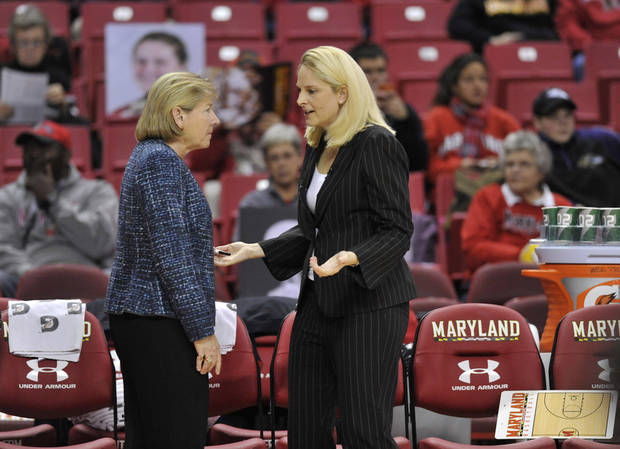 Maryland coach Brenda Frese, right, and North Carolina coach Sylvia Hatchell talk before an NCAA college basketball game between their teams on Thursday, Jan. 24, 2013, in College Park, Md. (AP Photo/Gail Burton).