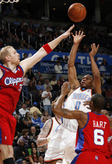 Russell Westbrook of the Thunder shoots between Chris Kaman, left, and Jason Hart of the Clippers in the second half of the NBA basketball game between the Oklahoma City Thunder and the Los Angeles Clippers at the Ford Center in Oklahoma City, Wednesday, Nov. 19, 2008. The Clippers won. 108-88. BY NATE BILLINGS, THE OKLAHOMAN