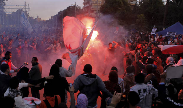 Egyptian protesters shout anti-Mohammed Morsi slogans before clashes in front of the presidential palace in Cairo, Egypt, Friday, Feb. 1, 2013. Thousands of Egyptians marched across the country, chanting against the rule of the Islamist President Mohammed Morsi, in a fresh wave of protests Friday, even as cracks appeared in the ranks of the opposition after its political leaders met for the first time with the rival Muslim Brotherhood. (AP Photo/Amr Nabil)