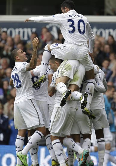 Tottenham Hotspur's players celebrate their goal against Aston Villa during a Premier League soccer match at White Hart Lane ground in London, Sunday, Oct. 7, 2012. Tottenham Hotspur won the match 2-0. (AP Photo/Lefteris Pitarakis)