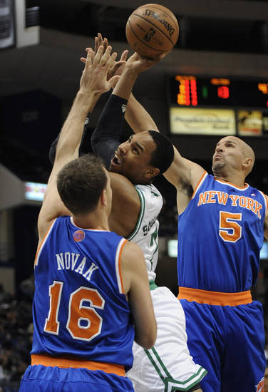 Boston Celtics' Jared Sullinger (7), center, is fouled by New York Knicks' Steve Novak (16) as New York Knicks' Jason Kidd (5) defends in the first half of an NBA preseason basketball game Saturday, Oct. 13, 2012, in Hartford, Conn. (AP Photo/Jessica Hill)
