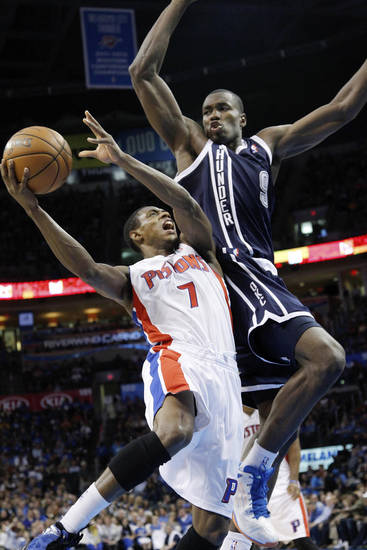 Detroit Pistons guard Brandon Knight (7) is fouled by Oklahoma City Thunder forward Serge Ibaka (9) during the second quarter of an NBA basketball game in Oklahoma City, Friday, Nov. 9, 2012. (AP Photo/Sue Ogrocki)
