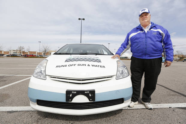 Middle Tennessee State University professor Cliff Ricketts and his team are driving from Georgia to California in a pair of cars powered by hydrogen rather than gasoline. He stopped in Midwest City on Tuesday in this modified 2005 Toyota Prius. <strong>Steve Gooch - The Oklahoman</strong>
