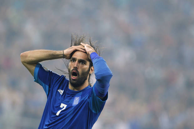 Greece's Giorgos Samaras reacts after a lost attack during their World Cup Group G qualifying soccer match against Bosnia-Herzegovina, at Karaiskaki stadium, in Piraeus port, near Athens, Friday, Oct. 12, 2012. (AP Photo/Petros Giannakouris)