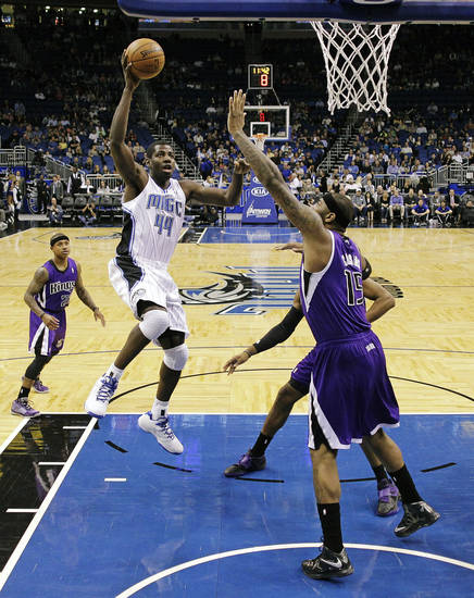 Orlando Magic's Andrew Nicholson (44) drives to the basket againstr Sacramento Kings' DeMarcus Cousins (15) during the first half of an NBA basketball game, Wednesday, Feb. 27, 2013, in Orlando, Fla. (AP Photo/John Raoux)