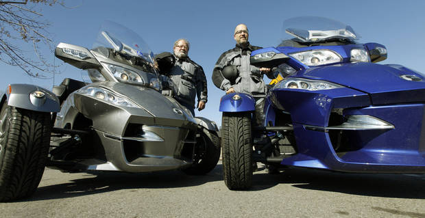 Don, left, and Daniel Baker, father and son, ride their three wheelers down a street in Edmond, OK, Friday, February 22, 2013, By Paul Hellstern, The Oklahoman