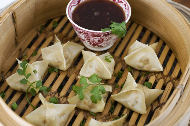 Vegetarian steamed dumplings with sweet-and-sour sauce. <strong>MATTHEW MEAD - AP</strong>