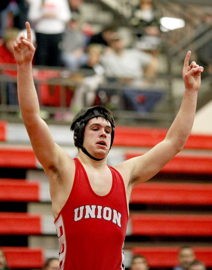 Union's Chance Wenglewski celebrates his win in the 6A 220-pound class during the finals of the State dual wrestling championship at Yukon High School in Yukon, Okla., Saturday, Feb. 11, 2012. Photo by Sarah Phipps, The Oklahoman