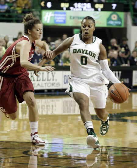 Baylor's Odyssey Sims (0) drives the lane against Oklahoma's Morgan Hook, left, during the first half of an NCAAcollege basketball game Saturday, Jan. 26, 2013,. in Waco Texas. (AP Photo/LM Otero) ORG XMIT: TXMO102