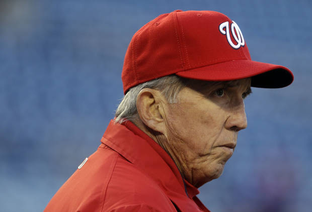 Washington Nationals manager Davey Johnson looks on as his team takes batting practice before Game 5 of the National League division baseball series against the St. Louis Cardinals, Friday, Oct. 12, 2012, in Washington. (AP Photo/Pablo Martinez Monsivais)