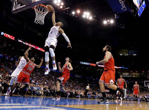 Oklahoma City's Russell Westbrook (0) dunks during the NBA game between the Oklahoma City Thunder and the Chicago Bulls at Chesapeake Energy Arena in Oklahoma City, Sunday, Feb. 24, 2013. Photo by Sarah Phipps, The Oklahoman