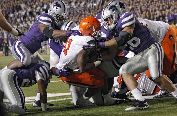 Oklahoma State's Jeremy Smith (31) is stopped by the Kansas State defense during the college football game between the Oklahoma State University Cowboys (OSU) and the Kansas State University Wildcats (KSU) at Bill Snyder Family Football Stadium on Saturday, Nov. 1, 2012, in Manhattan, Kan. Photo by Chris Landsberger, The Oklahoman