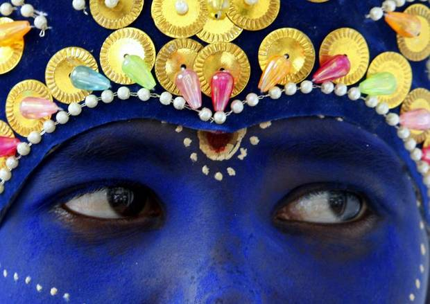 A child dressed as Hindu god Krishna takes part in Janmashtami celebrations to mark the birthday of Krishna  in Dhaka, Bangladesh, Monday, Aug. 22, 2011. Bangladeshi Hindus took to streets for the celebration.(AP Photo/ Pavel Rahman)