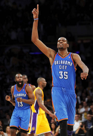Oklahoma City's Kevin Durant (35) reacts after James Harden (13), left in front of Los Angeles' Kobe Bryant (24), hit a pair of foul shots with 7.3 seconds left in the fourth quarter during Game 4 in the second round of the NBA basketball playoffs between the L.A. Lakers and the Oklahoma City Thunder at the Staples Center in Los Angeles, Saturday, May 19, 2012. Oklahoma City won, 103-100. Photo by Nate Billings, The Oklahoman