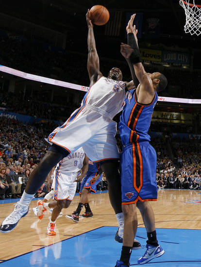 Kendrick Perkins (5) tries to get past Tyson Chandler (6) during the NBA game between the Oklahoma City Thunder and the New York Knicks at Chesapeake Energy Arena in Oklahoma CIty, Saturday, Jan. 14, 2012. Photo by Bryan Terry, The Oklahoman