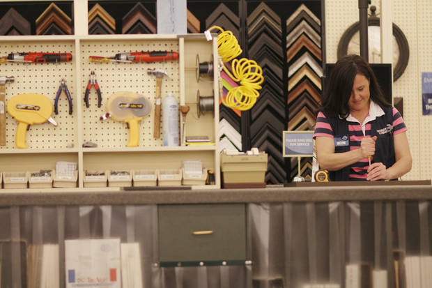 Heidi Cranor, framer at Hobby Lobby, assembles a frame at the Edmond store, 3160 S. Broadway,  Monday, April 15, 2013.  Photo by Doug Hoke, The Oklahoman