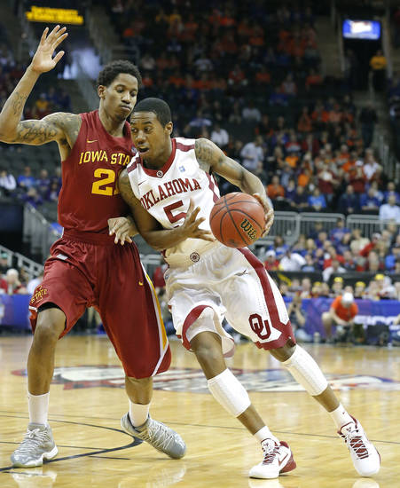 Oklahoma's Je'lon Hornbeak (5) drives to the basket at Iowa State's Will Clyburn (21) defends during the Phillips 66 Big 12 Men's basketball championship tournament game between the University of Oklahoma and Iowa State at the Sprint Center in Kansas City, Thursday, March 14, 2013. Photo by Sarah Phipps, The Oklahoman