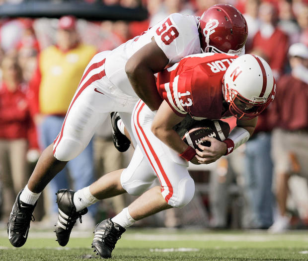 OU's Calvin Thibodeaux (58) sacks Nebraska quarterback Zac Taylor (13) during the first quarter of the Oklahoma Sooners at the Nebraska Cornhuskers college football game at Memorial Stadium in Lincoln, Neb., October 29, 2005. By Nate Billings/The Oklahoman