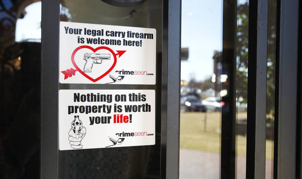 Stickers on the front door of Casa De Los Milagros Mexican Restaurant and Cantina communicate the business's stance on firearms. <strong>PAUL B. SOUTHERLAND - PAUL B. SOUTHERLAND</strong>