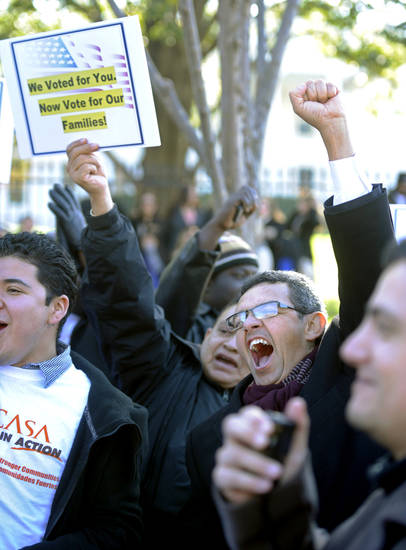 Gustavo Torres, director of Casa in Action, center right, and others, chant during a rally Thursday in front of the White House. Several religious leaders Tuesday called on Congress to pass an immigration reform package within 92 days of the start of President Barack Obama�s second term. AP FILE PHOTO