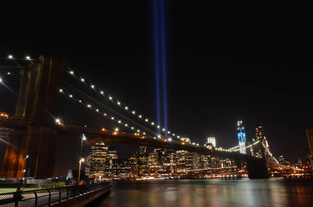 The Tribute in Light lights up lower Manhattan, Tuesday, Sept. 11, 2012 on the 11th anniversary of the terrorist attacks of Sept. 11, 2001 in New York. (AP Photo/Henny Ray Abrams)
