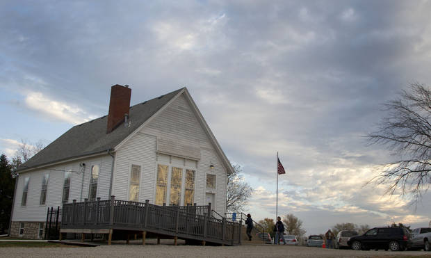 Voters arrive to cast ballots on Election Day, at Kanwaka Township Hall near Lawrence, Kan., Tuesday, Nov. 6, 2012. (AP Photo/Orlin Wagner)