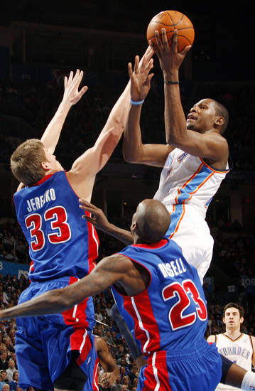 Oklahoma City's Kevin Durant (35) shoots the ball over Jonas Jerebko (33) and Walker Russell (23) of Detroit during the NBA basketball game between the Detroit Pistons and Oklahoma City Thunder at the Chesapeake Energy Arena in Oklahoma City, Monday, Jan. 23, 2012. Photo by Nate Billings, The Oklahoman