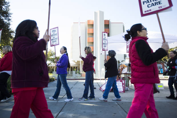 Registered nurses at Regional Medical Center of San Jose chant while protesting cuts in nursing staff, during a one-day strike Monday, Dec. 24, 2012, in San Jose, Calif. The strike is a part of protests held at nine Bay Area hospitals. (AP Photo/San Jose Mercury News, Dai Sugano) MAGS OUT  NO SALES