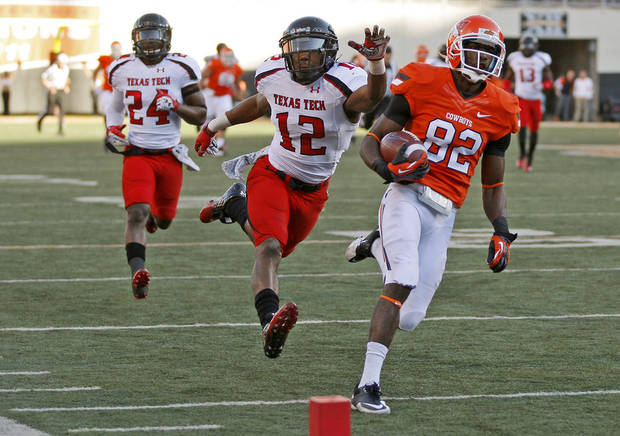 Oklahoma State's Isaiah Anderson (82) scores a touchdown in front of Texas Tech's D.J. Johnson (12) and Bruce Jones (24) during a college football game between Oklahoma State University (OSU) and Texas Tech University (TTU) at Boone Pickens Stadium in Stillwater, Okla., Saturday, Nov. 17, 2012.  Photo by Bryan Terry, The Oklahoman