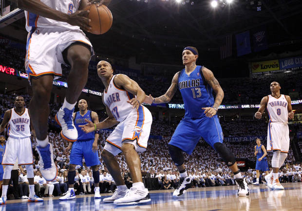 Oklahoma City's Serge Ibaka (9) tries to save a ball from going out of bounds