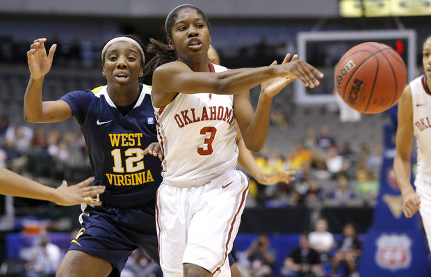 Oklahoma's Aaryn Ellenberg (3) passes the ball from in front of West Virginia's Darius Faulk (12) during the Big 12 tournament women's college basketball game between the University of Oklahoma and West Virginia at American Airlines Arena in Dallas, Saturday, March 9, 2012.  Photo by Bryan Terry, The Oklahoman