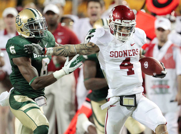 Oklahoma&#039;s Kenny Stills (4) catches long pass and is run out of bounds by Baylor&#039;s Ahmad Dixon (6) during the college football game between the University of Oklahoma Sooners (OU) and the Baylor Bears (BU) at Floyd Casey Stadium on Saturday, Nov. 19, 2011, in Waco, Texas. Photo by Steve Sisney, The Oklahoman