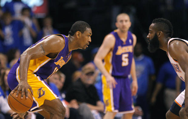 Oklahoma City's James Harden (13) defends against Los Angeles' Metta World Peace (15) during Game 1 in the second round of the NBA playoffs between the Oklahoma City Thunder and the L.A. Lakers at Chesapeake Energy Arena in Oklahoma City, Monday, May 14, 2012. Photo by Sarah Phipps, The Oklahoman