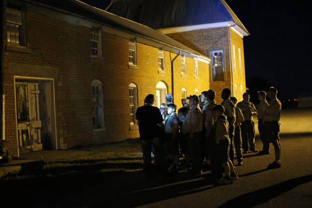 Rebecca Terrel, with the Sneak-N-Peek paranormal research and investigation team, tells stories to Boy Scouts from Troop 20 outside the post commissary during a  ghost tour by lantern light around the historic fort in El Reno on Saturday, Sept. 21, 2013. Photo by Bryan Terry, The Oklahoman