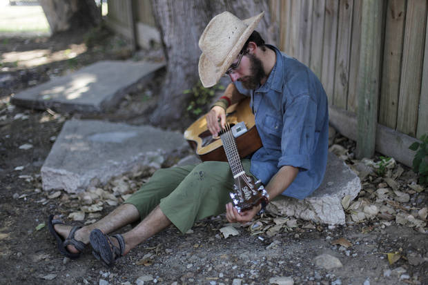 Peter Dieold, of Illinois, tunes his guitar during the Woody Guthrie Folk Festival in Okemah, Okla., Thursday, July 12, 2012.  Photo by Garett Fisbeck, The Oklahoman