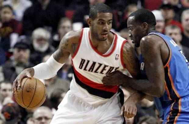 klahoma City Thunder center Kendrick Perkins, right, defends against Portland Trail Blazers forward LaMarcus Aldridge during the first quarter of an NBA basketball game in Portland, Ore., Sunday, Jan. 13, 2013. (AP)
