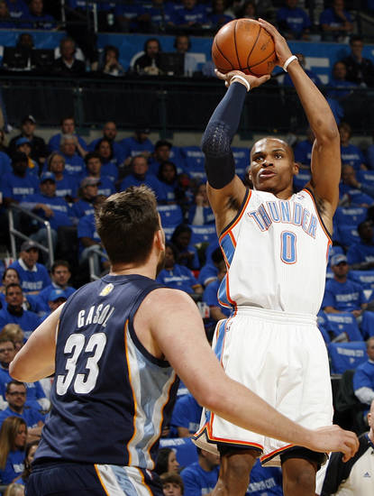 Oklahoma City's Russell Westbrook (0) takes a shot over Marc Gasol (33) of Memphis in the first half during game one of the Western Conference semifinals between the Memphis Grizzlies and the Oklahoma City Thunder in the NBA basketball playoffs at Oklahoma City Arena in Oklahoma City, Sunday, May 1, 2011. Photo by Nate Billings, The Oklahoman